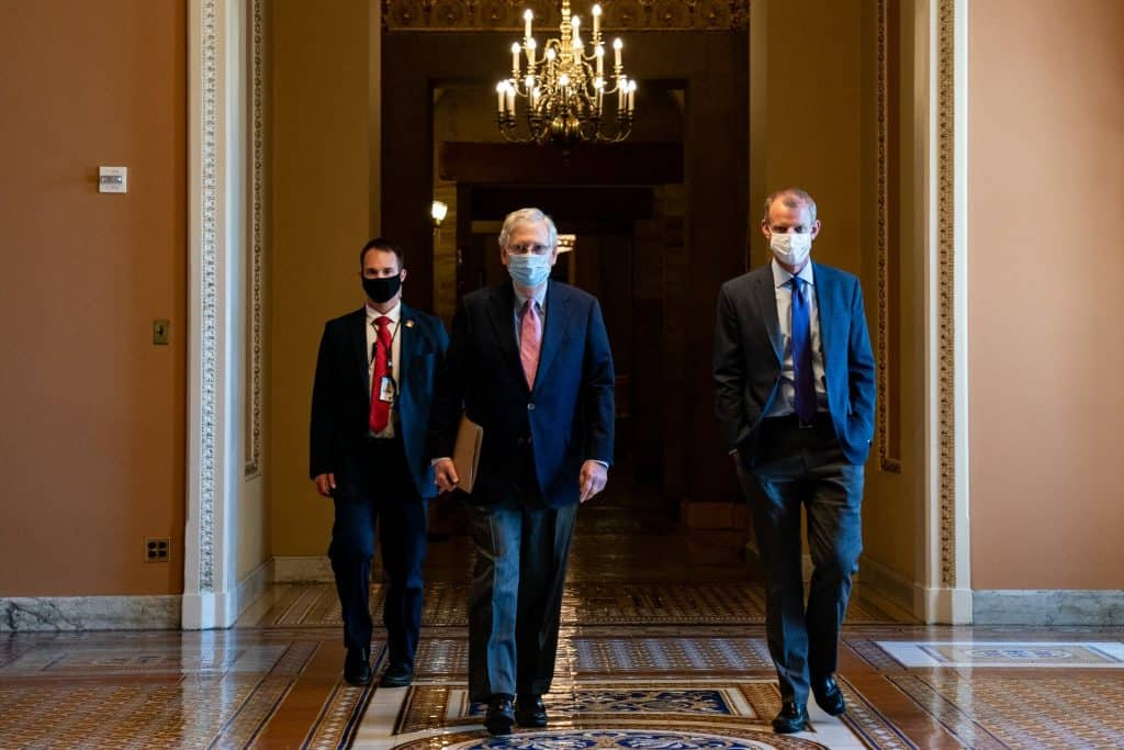"""""""Wearing simple face coverings is not about protecting ourselves, it is about protecting everyone we encounter,"""" Mitch McConnell, the Senate majority leader, said this week.Credit...Anna Moneymaker/The New York Times"""