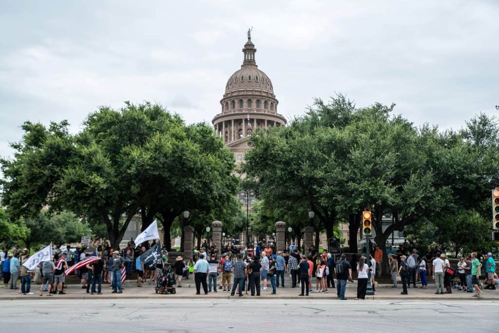 Demonstrators in Austin, Texas, protested against mandates to wear masks amid the coronavirus pandemic on Sunday.Credit...Sergio Flores/Reuters