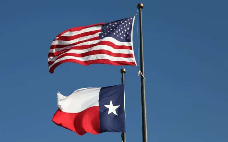 American flag and Texas flag flying at the LBJ Library in Austin. Loop Images/Universal Images Group via Getty Images